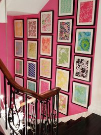A Lily Pulitizer print framed stairway. What a way to start the day! (Not sure about the pink paint, though.)