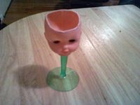 how to make a wine glass out of a dolls head haha funny, it would be cooler if the doll was horror looking with blood down stem of glass LOL #weird