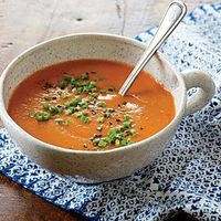 Roasting the tomatoes and garlic brings out a deep, savory flavor, allowing us to use less salt and save 450mg sodium per serving over traditional tomato soup.