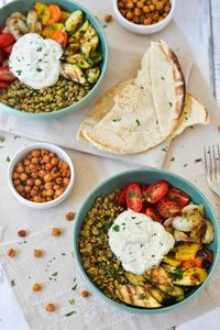 Middle Eastern inspired lentil bowl with grilled veggies, tahini-yogurt sauce and crispy roasted chickpeas.