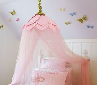 A hula hoop is an inexpensive way to decorate a little girls bedroom and make her feel like a princess.