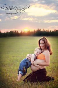 Mom/baby belly and toddler with sun setting-so pretty!