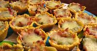 Tamale bites filled with bacon, diced jalapeno's and Monterey jack cheese perfect for a party!