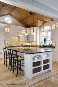 not my first choice of white marble, but i like the look, plus we have black stools and light floors and walls anyway