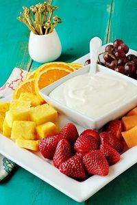 Cream cheese, marshmallow fluff and orange zest combine to create the perfect dip for summer fruit.