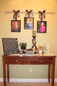 hang photos from a curtain rod. cute!