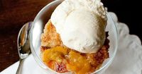 Peach Cobbler~~ I have my own version, which I adore (also, I add a pinch, or 1/2 pinch, of nutmeg)....but, this will remind me to DO it!!! We also used to dribble sweetened (&vanilla) heavy cream over...Not whipped, not ice cream...ju...