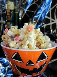 Monster Munch - popcorn, candy corn, peanuts & Reeses pieces coated with white chocolate - totally addictive!