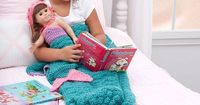 Mermaid Fantasy Blanket Free Crochet Pattern in Red Heart Yarns -- Feel pretty as a mermaid as you cozy up under the perfect blanket. Escape to a wonderland as you read and share your dreams with your doll. This blanket is easy to crochet in favorite colo...