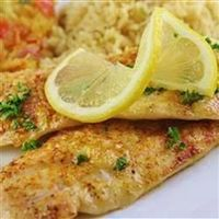 Tilapia Scampi- I did not bake it, i just grilled it on the pan, i added two scoops of butter on low temp, added 2 garlic gloves minced, added a little bit of salt and pepper to filets before putting them on the pan, added about two tsp of lemon juice, ad...
