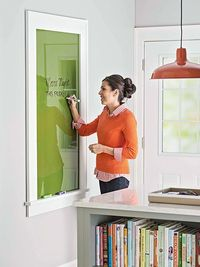 Create a dry erase message center from a framed piece of glass! Great for getting organized for back to school!