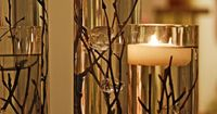 Twigs in water with floating candle on top. Simple and beautiful.