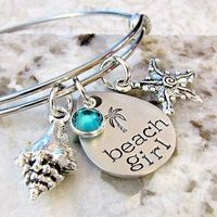 Calling all mermaids! This hand-stamped stainless steel silver bangle bracelet by Lily Brooke Vintage features a pewter teardrop pendant, Tibetan silver charm accents and a beautiful aqua channel set Swarovski crystal. It's makes for a perfect gift ...