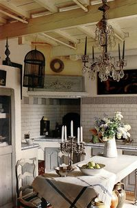 Small kitchen dining, complete with a charming chandelier