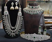 Nice looking luxurious indian bridel set in american diamonds, one long necklace,one choker,one hipbelt,two pair earrings1gram jewellery set $785.00
