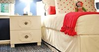 Sarah Catherine Designs | Navy & Coral | Bright Pom Pom Throw | Area Rug | White Headboard | Navy Walls