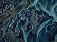 It's easy to forget how beautiful our blue marble can be. But photographer Edward Burtynsky's aquatic landscapes have given us a new appreciation for the water