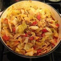 Unstuffed Cabbage Roll 2lb beef 1 lg onion 1 sm cabbage 2-14.5oz can diced tomatoes 1 8oz can tomato sauce 1/2c water 2 cloves garlic 2t salt 1t pepper Cook beef & onion in hot Dutch oven drain Add cabbage tomatoestomato sauce watergarlic salt/pepper ...
