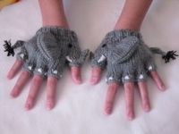 Elephant fingerless gloves won 3rd Place in a Vanna's Choice yarn contest 2010. Knitted by Sui Hom.