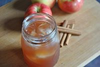 This apple cider cocktail has spiced rum and cranberry juice, perfect for a fall treat.