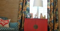 the curtains with the wall treatment with the ceiling with the red dresser with the love pillow... very nice!