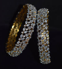 Diamond finish bangles with Swarovski stones in 1 gm gold bangles. $100.00