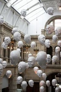 Ever get that creepy feeling that a hundred set of eyes are watching you? Thanks to Sophie Cave, this nightmare has turned into a reality! The Floating Heads in