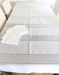 Rectangular tableclothe white linen veil, strips of openwork crochet squares, 116 inches, 12 place settings �'�117.00