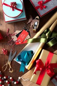 """Sitting on the floor surrounded by paper, ribbons, tags and tape is not a bad place to be. Create a look for your gifts�€""""even if they are all in different colors"""