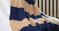 Love the pattern and big stripes in this afghan! // FREE Knitting Pattern --- Easy Breezy Afghan from Joann.com