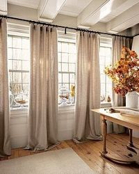 Love the curtains across all the windows with long rod