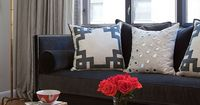 living rooms - Anthropologie Ikat Bowl CB2 Clear Peekaboo Coffee Table Worlds Away Gold Leaf Bamboo Iron Floor Lamp Base Greek Key Fretwork Throw Pillow Reflections Cotton Canvas Pillow with Mirror Embroidery gray linen drapes Greek key trim black velvet ...
