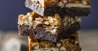 Rich and fudgy dark chocolate brownies are topped with crunchy pretzels, potato chips, and peanuts, then drenched in buttery caramel, for a sweet/salty junk foo