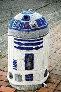 This is quite possibly my favorite yarn bombing of all time. Sarah Rudder created a knitted R2D2 cover for a concrete street post in Bellingham, Washington