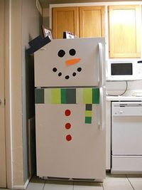 "Fun for next year! :""Snowman fridge!"" -- It would be cute to do this with the eyes, mouth, nose, buttons and hat as magnetic. That would keep kids busy for a while!"