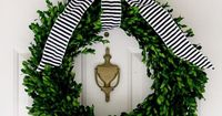boxwood wreath tied with a bow.