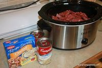 Crock Pot Round Steak Per Batch: 1 pound (give or take) round steak 1 can cream of mushroom soup 1 pack dry onion soup mix 1/4 cup water Sour cream to taste