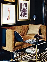 I love the pairing of the lacquered inky blue wall that gives a liquid look paired with the softness of this camel colored velvet couch, oh and the zebra print and purple callas polish it off