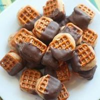 Peanut Butter Balls between pretzels and dipped in chocolate