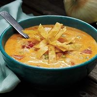 Creamy Chicken Enchilada Soup | Apron Free Cooking http://www.apronfreecooking.com/family-feature/fresh-takes-on-family-recipes/