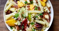 An easy summer dinner of grilled peaches, heirloom tomatoes and pasta in a basil vinaigrette.