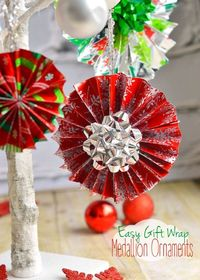 These easy Gift Wrap Medallion Ornaments are so easy to make and add a festive flair to your tree and Christmas gifts! A fun craft for kids of all ages! MomOnTimeout.com | #craft #Christmas #MakeAmazing #spon