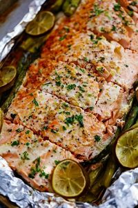 Buttery Garlic Lime Salmon with Asparagus in Foil is so easy to make with simple ingredients. The flavor makes this ...