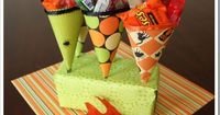 Halloween Treat Cones are a fun way to hand out sweets to all the little ghosts and goblins! They are so simple to make! Start with a selection of 12 x 12�€ scra