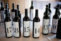 Wedding table numbers. Then have each guest at the table sign the bottle and the bride and groom open that bottle on that number year of their anniversary.