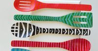 Looking to add a little color to your kitchen? Check out how easy it is to make this spoon display! www.jaderbomb.com #homedecor #diy #wood #easycrafts