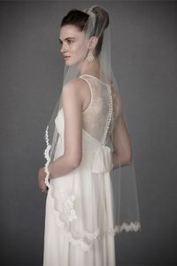 Scalloped Fingertip Veil It's our first fingertip veil and we couldn't be happier with it! A lovely choice for any dress length, Debra Moreland's scalloped French Alencon lace begins at the shoulders and wraps all the way around back lea...