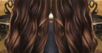 #6: Light Chocolate Curls For bombshell hair, go for a light chocolate base color with caramel balayage highlights on the face-framing pieces and on the ends. T