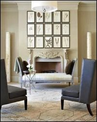 Modern chairs and ornate fireplace mantel are a wonderful mix. It feels like a Parisian apartment