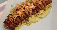 Get this all-star, easy-to-follow Grilled Pork Tenderloin al Pastor with Avocado Crema recipe from Jeff Mauro